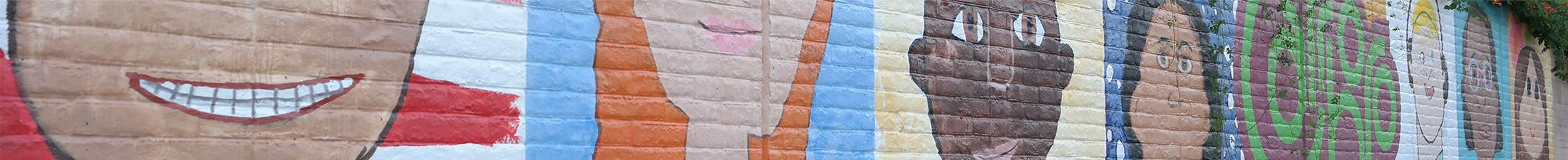 Caricature portraits painted on brick wall